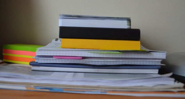 A stack of books and notes, probably full of scribbled revisions